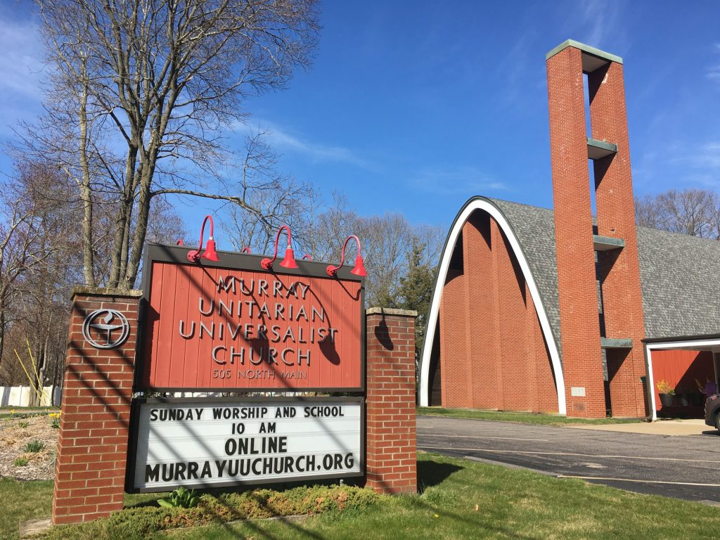 Photo of the front of church and sign